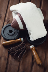 American football with a towel, weight disks and a jumping rope