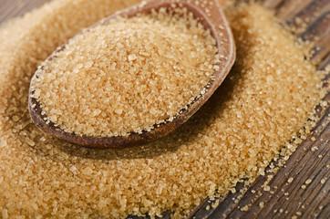 Raw Organic Cane Sugar in a wooden spoon