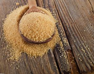 Organic Cane Sugar in  a wooden spoon
