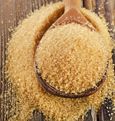 Organic Cane Sugar in  wooden spoon