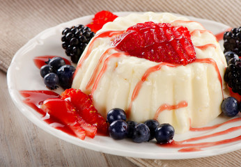 Delicious  dessert with fresh berries .