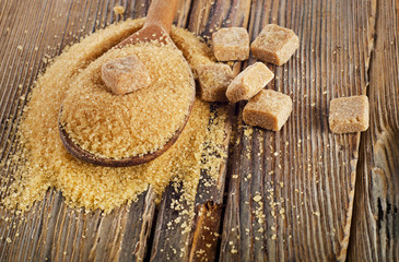 Brown Cane Sugar in  wooden spoon.