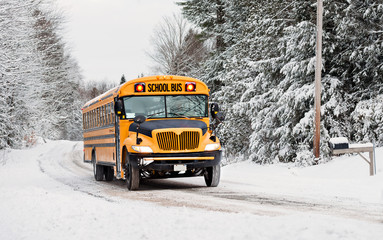 School Bus Driving in Winter on a Snow Covered Road