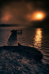 Fog Beyond the Dock on a Lake at Sunrise