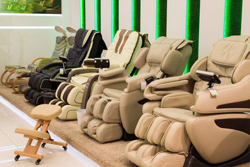Beige massage chairs in the store