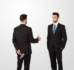 Two businessman shake hands