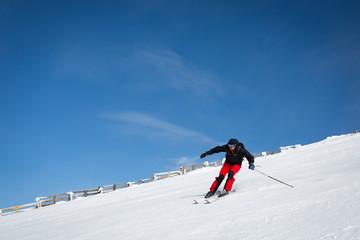 Man sliding on ski