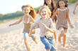 canvas print picture - Portrait of children on the beach in summer