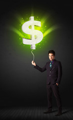 Businessman with a dollar sign balloon