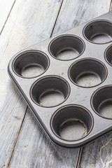 Muffin tray on wooden table