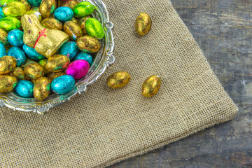 Easter eggs and Easter chocolate bunny on rustic wooden table