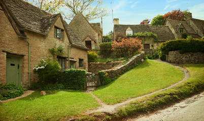 Traditional Cotswold cottages in England, UK.