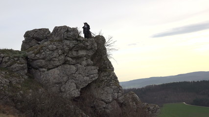 Female Scout standing on Cliff