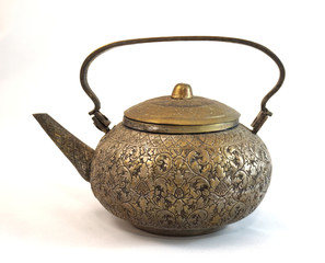Antique brass teapot isolated on the white background