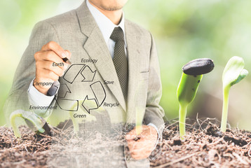 double eposure business man drawing recycle green conserve envir