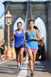 New York runners running on Brooklyn bridge NYC