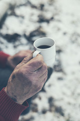 Old Man Hand Holding a Cup of Coffee
