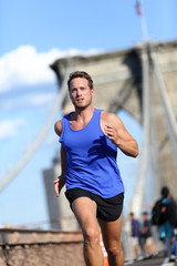 Man runner running on Brooklyn bridge in New York