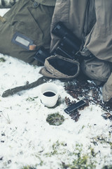 Cup of Coffee and Belongings on a Snow