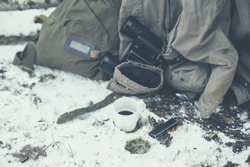 Explorer Belongings on the Ground with Snow