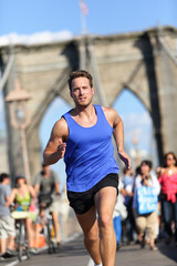 Running athlete training on Brooklyn bridge, NYC