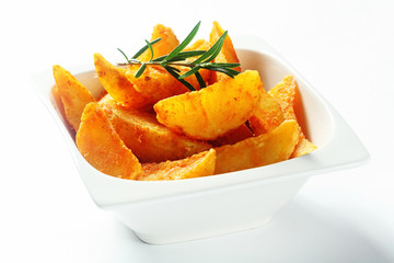 Gourmet Fried Potatoes with Rosemary Herb on Top