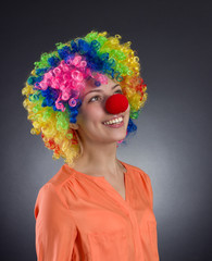 Clown. Portrait of happy girl in colored wig