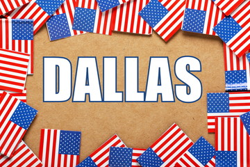 The title Dallas with a border of USA Flags