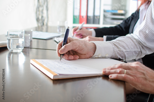 Business people taking notes - 78148364