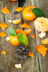 Tangerines with leaves on a wooden table