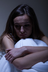 Woman with depression at night