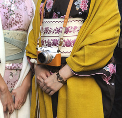 Two geishas with camera