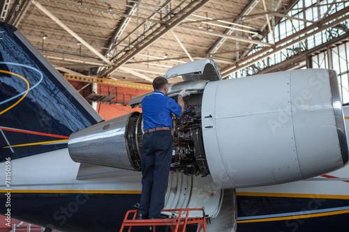 Plexiglas Vliegtuig Business jet airplane stays in hangar..