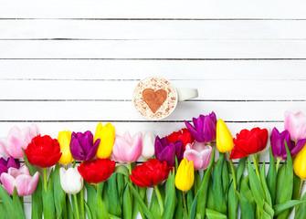 Cappuccino near tulips