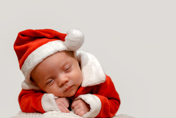 Cute Baby Sleeping in a Santa Claus Suit