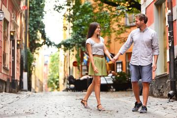 Happy couple in love walking in Stockholm city