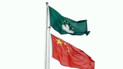 State Flag of Macau and China flutters on a mast