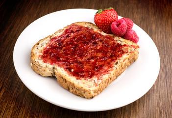 Mixed fruit jam on healthy whole wheat multi grain toast