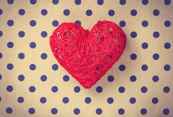 Heart shape decorate toy on polka dot background.