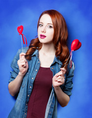 Portrait of a beautiful redhead girl with toy