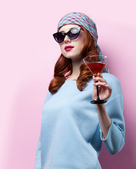 Portrait of beautiful redhead girl with drink