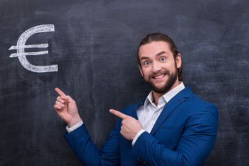 Male standing in front of blackboard background