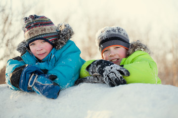 Portrait of two happy brothers in winter clothes