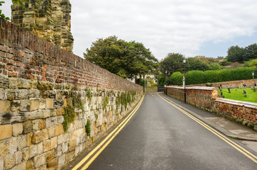 Straight Narrow Road Lined with Stone Walls