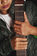 Female hands holding an acoustic guitar