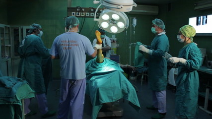 Surgeons team performing surgery in operating room