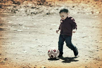 Little Boy Making the Shot with a Soccer Ball