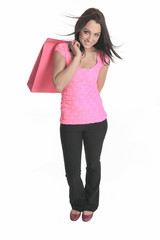 A young woman well dressed with bags on studio white background