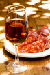 Glass of sherry with a snack (ham, jamon, parma). - 78158971