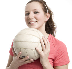 Happy Young Girl Holding Volleyball Isolated On White